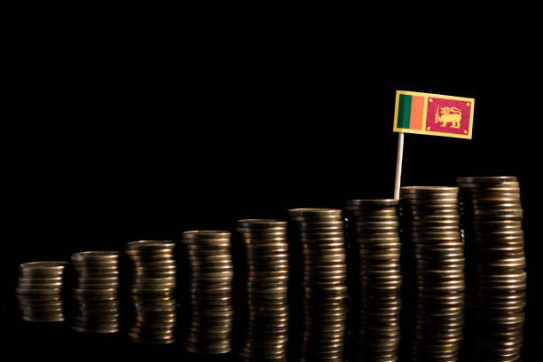 sri lankan flag with lot of coins isolated on black background