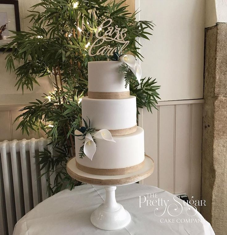 Cala lily, ferns and thistles sugar flowers with personalised wooden topper wedding cake