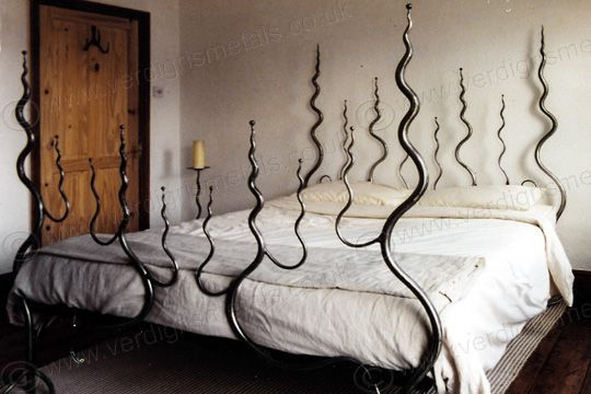 Gothic wrought iron fantasy bed - could be a tad ouchy if you fell on those spikes...