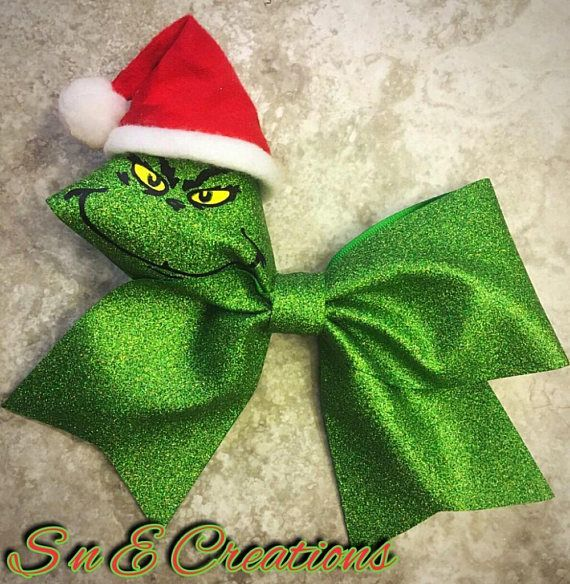 The GRINCH Christmas cheer bow On a lined alligator clip with teeth Measures approximately 7 x 6