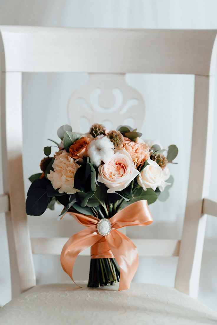 bridal bouquet In a gentle peach color with the use of tender carnations, cotton and peach roses
