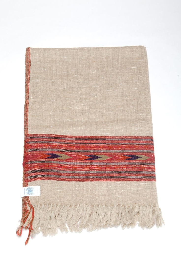 Parvati - Named for the Goddess Parvati, which also means Mountain. A soft camel-coloured backdrop with pale yak wool woven in. The wide border blends deep red with tiny black checks.