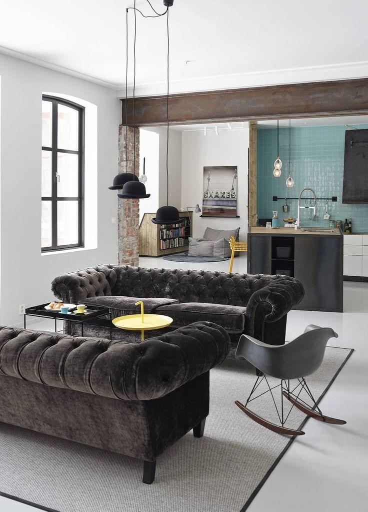 Oslo apartment Photo: Sveinung Braathen grey chesterfield, teal wall, bowler hat pendant lights, eames rocker