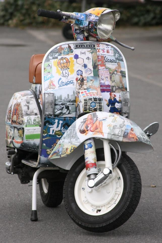 Vespa covered with montage of Vespa Print Advertising…