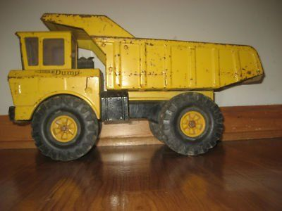 Old metal Tonka trucks  of the 70's. My brother had one just like this this. <3