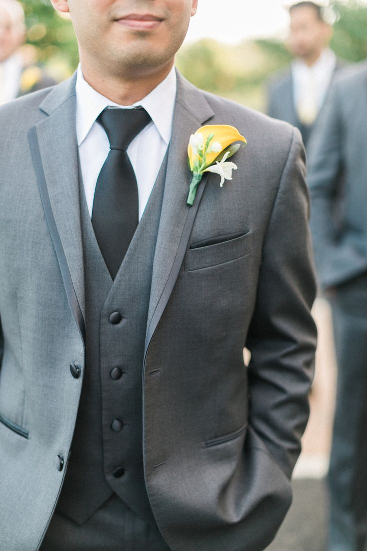 Groom boutonniere, yellow calla lily with white accent, gray tuxedo