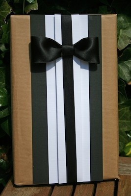 Gift Wrapping Idea for guys - Tuxedo Looking Gift Wrap. This is a form of Japaneses pleating.
