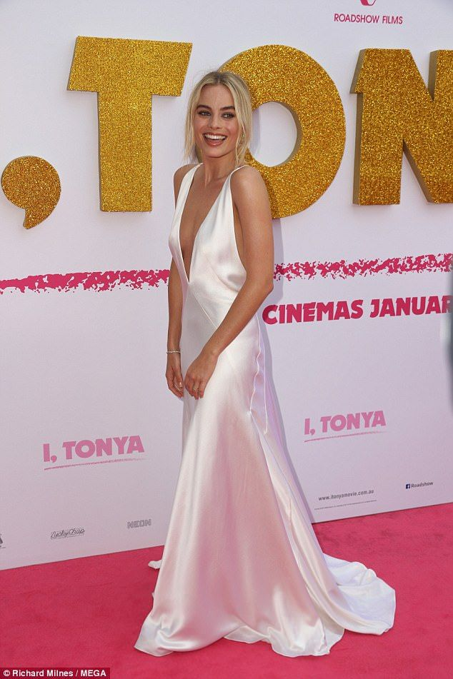Taking the plunge! Margot Robbie showcases her cleavage in a VERY low cut dress as she lea... #margotrobbie #celebrities #redcarpetglamour