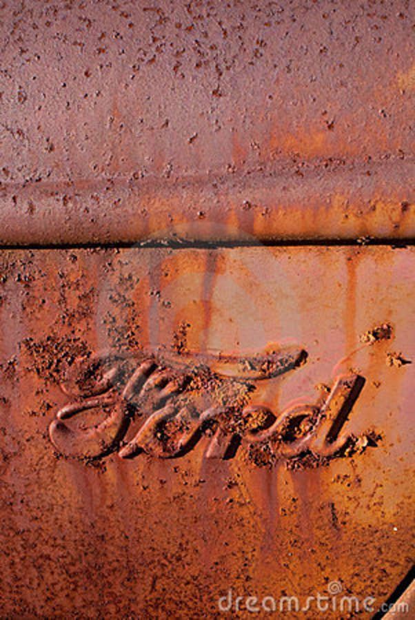 old rusty antiques | Photo depicts Ford Logo on old rusty antique pickup truck.