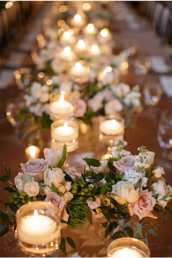 Candles, tiny pink/blush roses, gold accents.