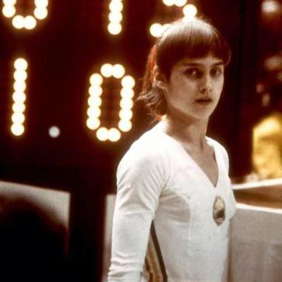 Stunning Olympic moments: Nadia Comaneci scores a perfect 10, Montreal 1976.  In Montreal, for the first time in the history of the modern Olympics, Nadia scored a perfect 10 on the uneven bars event. Because the scoreboards did not even have enough space to show a 10, Nadia's score appeared as 1.00. By the time the Games were over, Nadia had scored a grand total of seven perfect 10s, winning an all-around gold medal and helping her team to win silver.