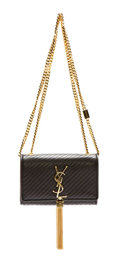 Quilted buffed leather shoulder bag in black. Gold-tone hardware. Curb chain shoulder strap. Fold-over flap at main compartment with magnetic press-stud closure. Signature monogram accent and micro chain tassel detail at flap face. Card slot at bag interior. Designed by Yves Saint Laurent. http://www.zocko.com/z/JJ6RG