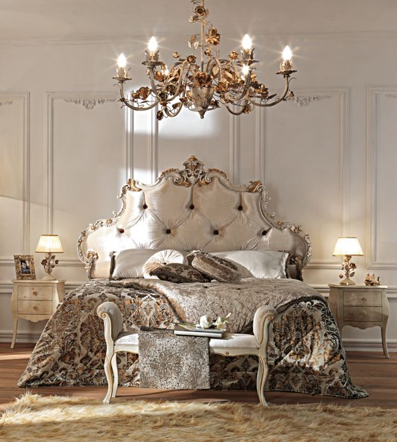 Silk bed in taupe silk with an antique ivory and gold detailed frame.