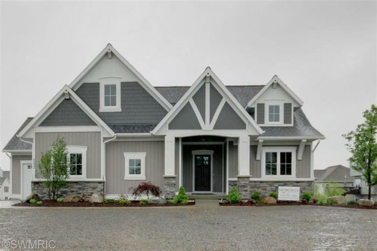 gray siding houses - white trim ..check out the stone on the bottom and the two tone gray..darker upper half. Note the four square windows and stone around the pillars. Note the Arts and crafts garage door.