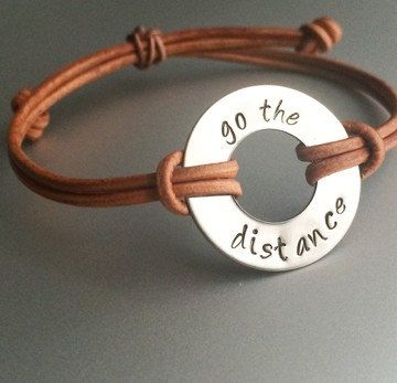 Go the distance - hand stamped on your choice of stainless steel or zinc (both are 1) naturally dyed genuine Indian leather available in 4 natural