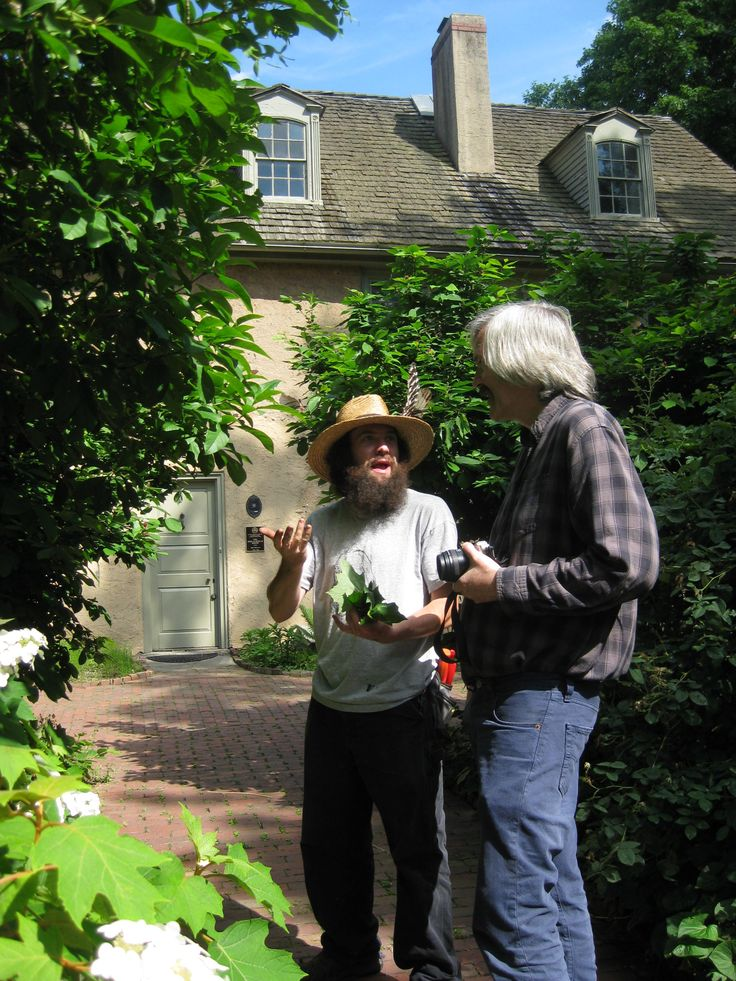 Head Gardener Todd Greenberg and Curator Joel Fry by the east-facing front of the Bartram House