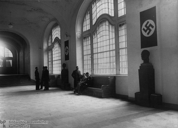 Busts of Hitler (right) and Göring (left) in the Main Hall of the Secret State Police Office at 8 Prinz-Albrecht-Straße (1935) . The Secret Police Office (Gestapa) at 8 Prinz-Albrecht-Straße, Berlin, was the central headquarters of Prussia's political police from May 1933 on. After Himmler was appointed inspector and deputy head of the State Secret Police in April 1934, he chose Reinhard Heydrich as head of the Gestapo