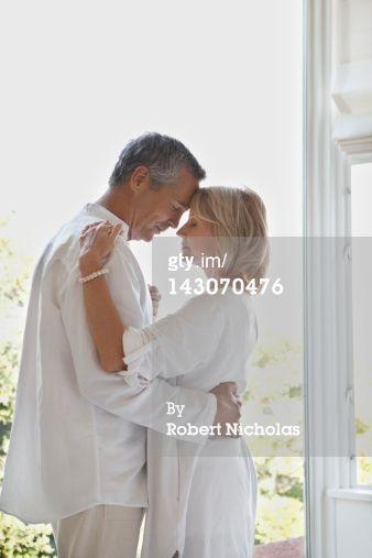 Royalty-free Image: Older couple dancing in doorway