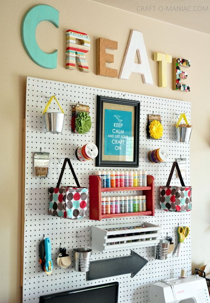 Our new Sketch collection frame would be a PERFECT fit in any craft room with it's fun, chalkboard finish! Use it to custom frame peg boards like this one, memo boards, cork boards, or even chalkboards - then, the whole thing is a usable surface. Brilliant!
