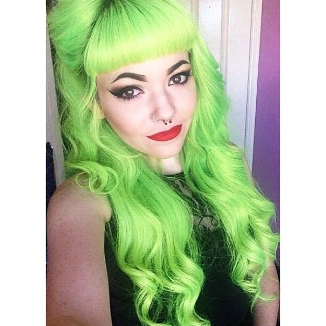 Bright neons green curled hair half updo with Bettie bangs