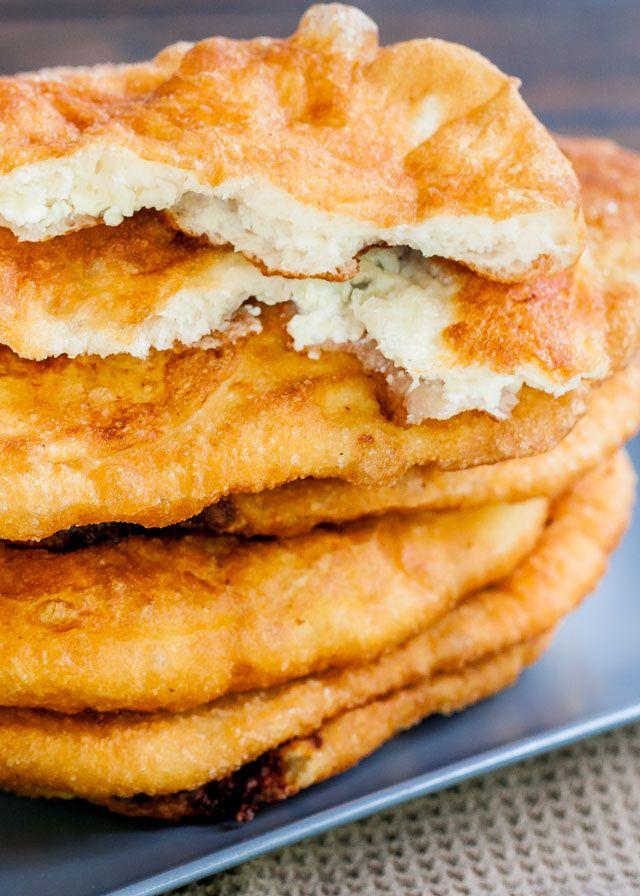 "Fried Dough Filled with Feta Cheese a.k.a. ""Langosi cu Branza"" - a traditional Romanian popular street food. Delicious fried dough filled with feta cheese."