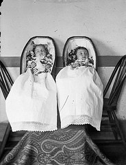 """Memento Mori: Postmortem Photographs.   This is one of the Charles Van Schaick photographs that was used in the book """"Wisconsin Death Trip."""" It's a portrait of deceased twin infants in coffins: Robert and Janet Fitzpatrick were born on July 5, 1885, and died April 20, 1886. This mourning ritual was widespread in19th-century America - I find it fascinating."""