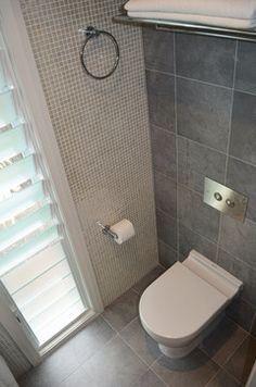 Tall, skinny louvre window in family bathroom
