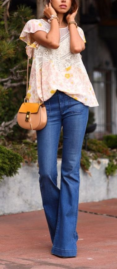 Get the modern hippie look with tailored flared jeans and light floral blouse for Spring.