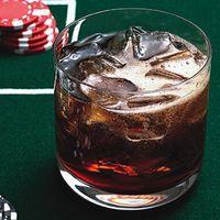 Black Jack  2 oz Jack Daniels  10 oz Vanilla Coke  Serve over ice .. hmm.. thinkin we might havta try this