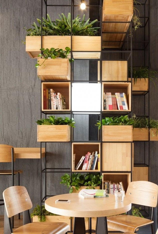 Architecture firm Penda have designed the interiors of Home Café, using recycled steel bars as dividers.