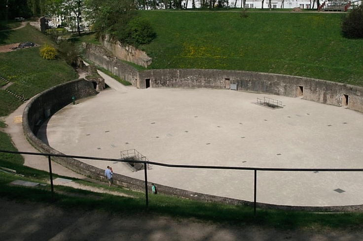 ruins of the Roman Amphitheater in Trier, Germany. The 2 openings in the bottom are where they kept live animals for gladiator fights -- and there are cells along the sides and underneath for criminals, etc.