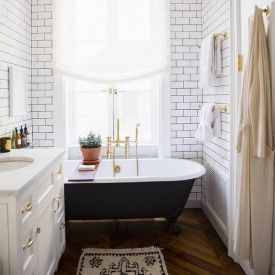 An ode to beautiful dark clawfoot bathtubs, inspired by Jenna Lyons' home in Domino Magazine.
