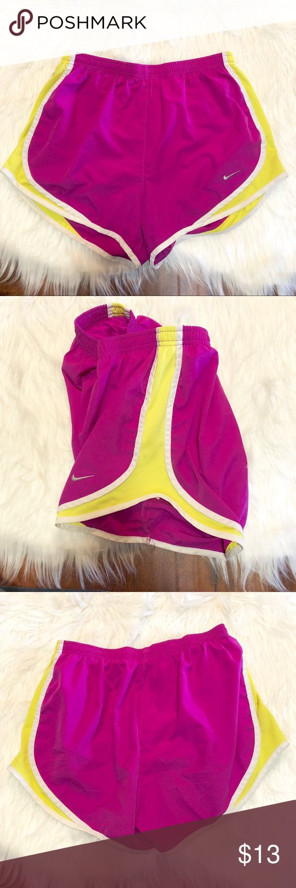 Nike Dri-fit Tempo Running Shorts Pink Yellow S Nike Dri-Fit Tempo Running Shorts  Size Small  Good pre-owned condition; interior size label is somewhat rubbed off from washing. From a smoke-free home.  Color is somewhere between a bright pink and fuchsia- very bright and cheery :-)  -Hidden pocket inside for key, ID, fuel, etc. -Dri-FIT® fabric wicks away moisture and keeps you dry and comfortable -Built-in briefs for ultimate coverage -Elastic waistband with mesh panels on sides/hips…