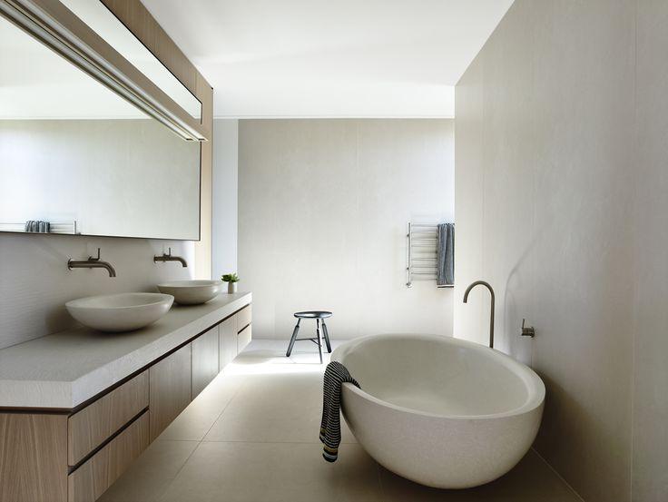 Limed oak veneer, concrete bath and basins Boyd Alternatives, Stone Italiana 'Jaipur' bench top. Rob Kennon.