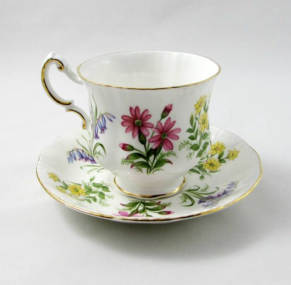 Lovely white tea cup and saucer with pretty colorful flowers. Pattern is English Flowers. Made by Paragon. Gold trimming on cup and saucer edges. Excellent condition (see photos). Markings read: By Appointment To Her Majesty The Queen China Potters Paragon Fine Bone China England Regd