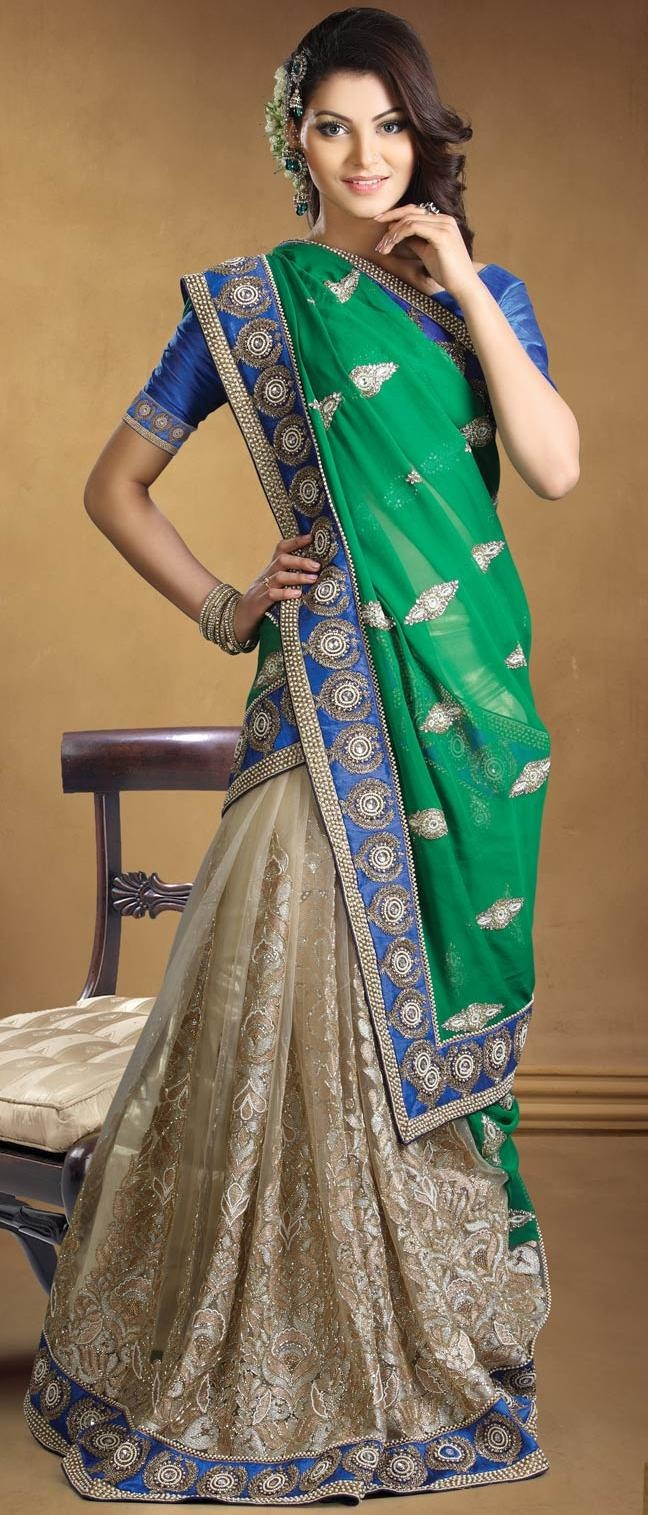Green and beige georgette and net Lehenga style saree with blouse.