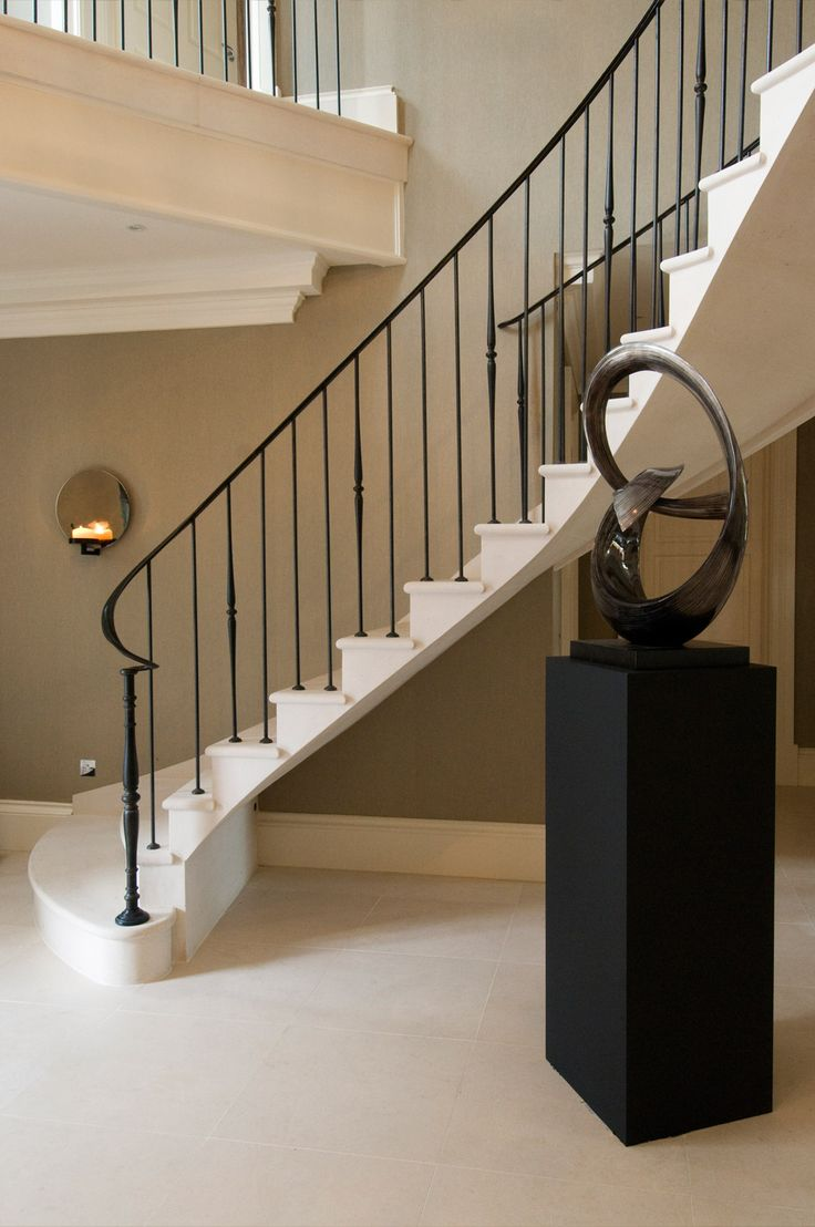 19. Moleanos stone cantilever stair with elegant metal balustrade and matching flooring – Surrey