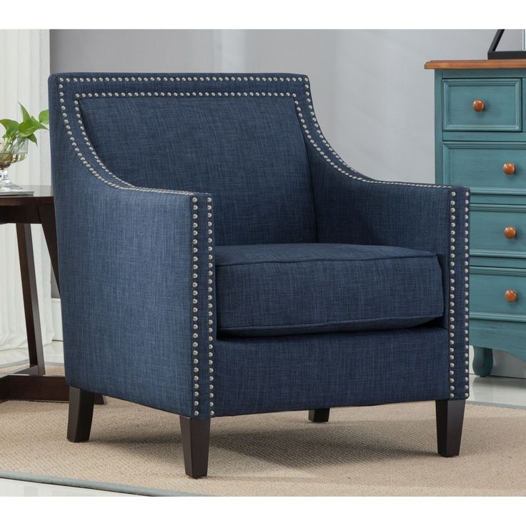 Bring home the chic style of the Greyson Living Tanner Blue Accent Chair. This chairs sloping arms and thick reversible seat cushion with sinuous no-sag springs. Highlighted by double rows of chrome n