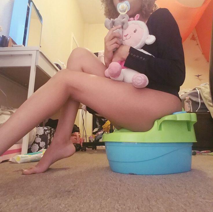 Cute brunette girl loves to fart on the toilet on webcam