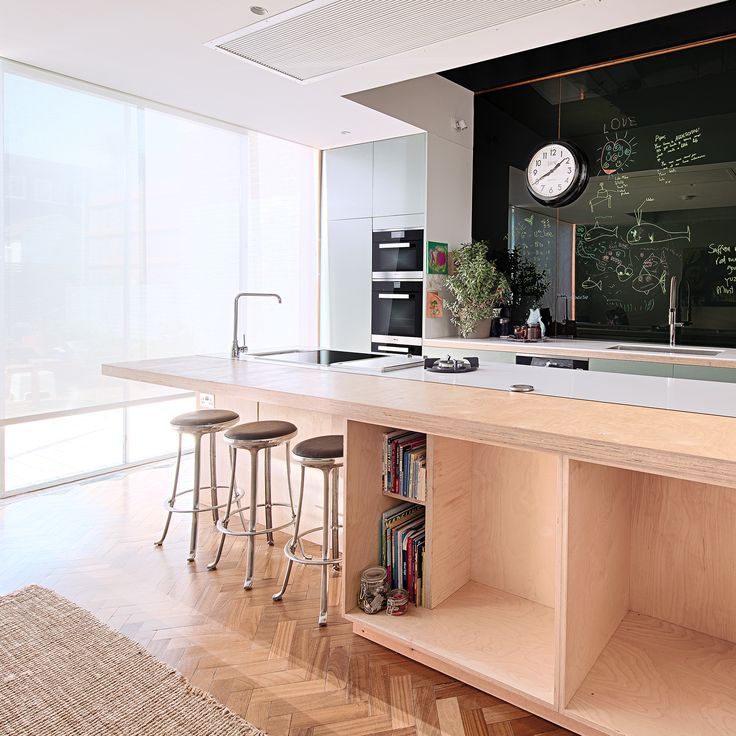 Plenty of storage space is an important aspect in many family kitchens. Chef and owner of acclaimed restaurant The Modern Pantry, Anna Hansen MBE's kitchen features a large central island, with plenty of storage and a seating area #kitchendesign