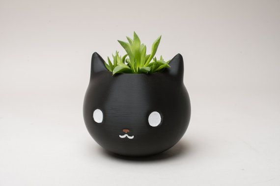 Super cute cat head planter. We offer 3 different sizes. If you need a specific size, please send us a customize order request.  We can also