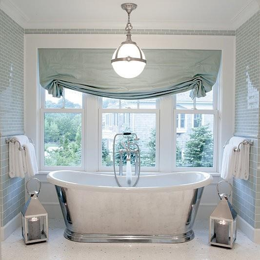 Glamorous bathroom with gorgeous relaxed roman shade! Mint and white