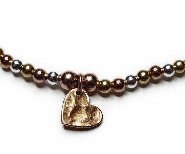 Mixed metal heart charm bracelet