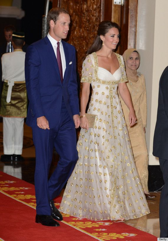 Kate and William in Kuala Lumpur. Kate's wearing a stunning Alexander McQueen evening gown, complete with gold star details and a white sheer overlay.