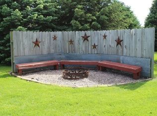 Rustic Landscape and Yard with Fence & Fire pit in Ankeny, IA | Zillow Digs