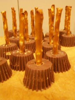 Incredibly easy to make: witches broomsticks using peanut butter cups and pretzel sticks.