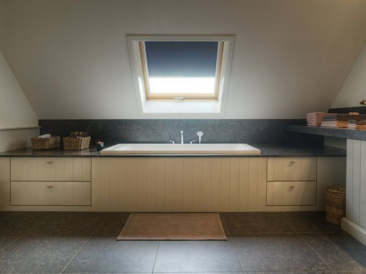 Cottage bath surround with storage. Top plate in natural stone. Perfect combination, designed by Dzignstone.