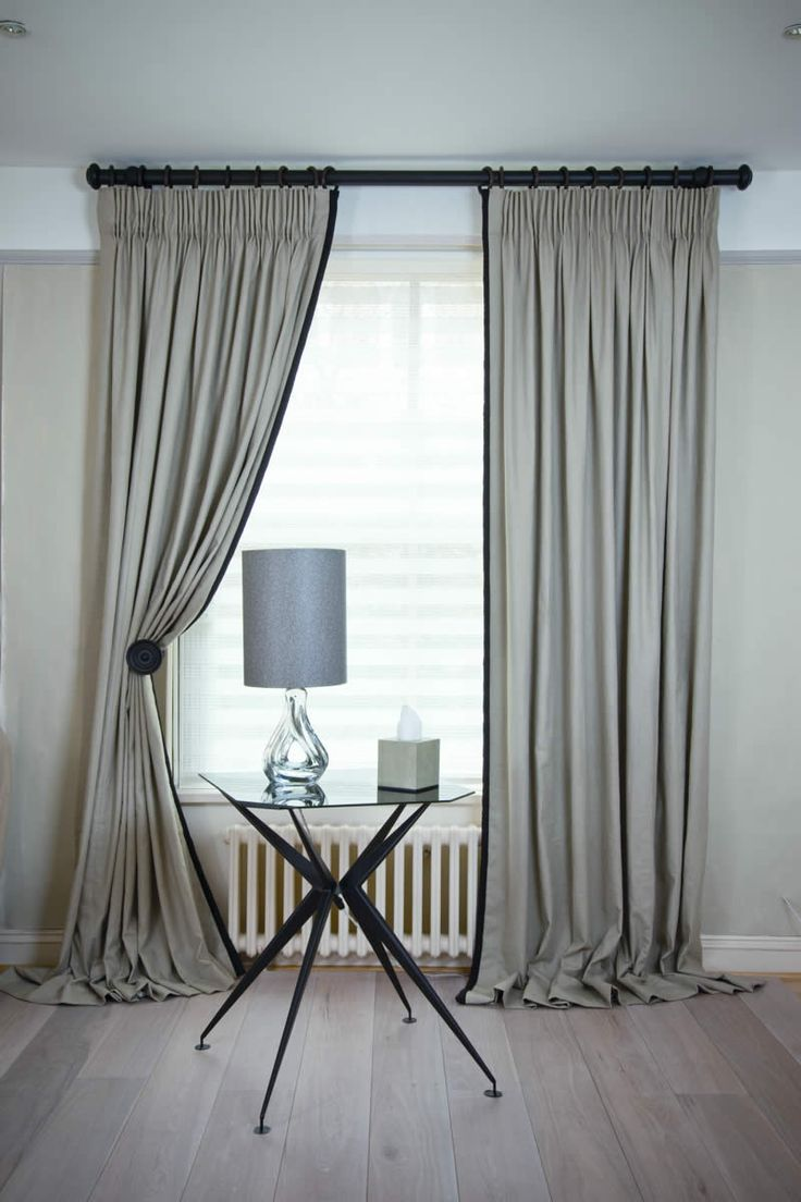 Kildare Limestone curtains with king pleat heading with leading edge border in Kildare black with jumbo piping
