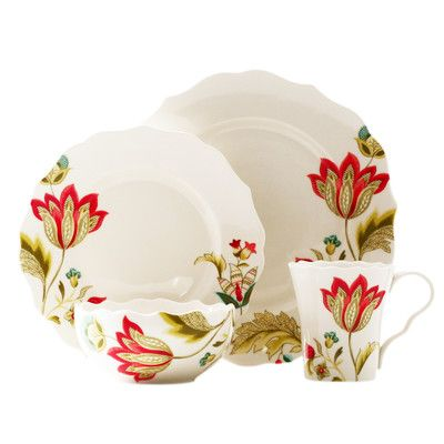 Enhance your tastefully set tablescape with this Oneida Italian Cypress 16 piece dinnerware set. It features a delightful combination of warm colors on white porcelain in a fun and festive floral design that is enhanced by colorful dotted edges. The set has an appealing combination of floral imagery and warm colors that will bring joy to your meals.
