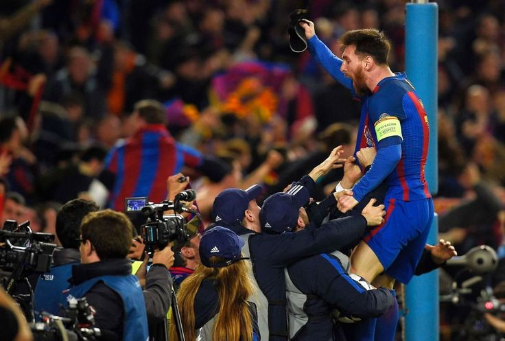 TOPSHOT - Barcelona's Argentinian forward Lionel Messi celebrates their victory at the end of the UEFA Champions League round of 16 second leg football match FC Barcelona vs Paris Saint-Germain FC at the Camp Nou stadium in Barcelona on March 8, 2017. / AFP PHOTO / LLUIS GENE